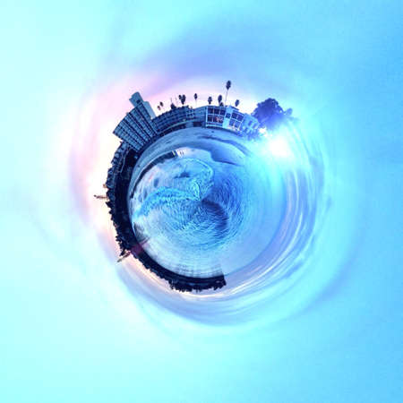 dun: Abstract globe with beach and city skyline at sunset! Stock Photo