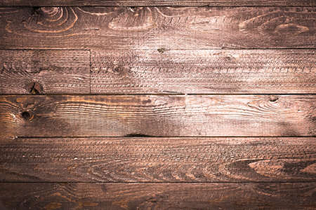 Natural Dark Wooden background. Old dirty wood tables or parquet with knots and holes