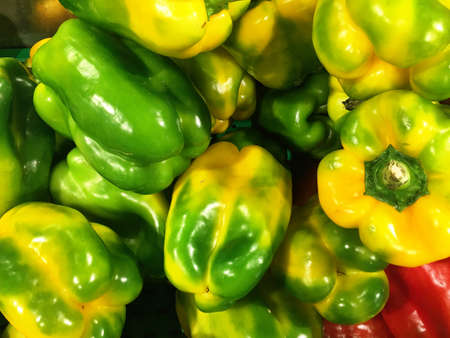 Close up of a big box of Peppers at the super market in vegetables section.