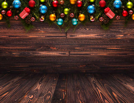 spruce: 2017 Happy New Year seasonal background with real wood green pine, colorful Christmas baubles, gift boxe and other seasonal stuff over an old wooden aged background