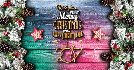 2017 New Year  Frame with green pine, colorful baubles, knots with berries,stars and other seasonal stuff over an old wooden aged background Stock Photo