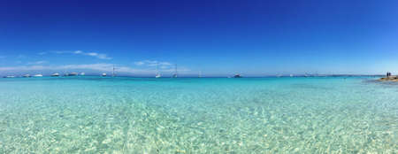 water waves: Beatiful Sunny Beach day in Formentera Spain in the middle of the holiday summer season. Stock Photo