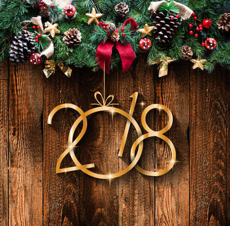 2018 Happy New Year and  Merry Christmas Frame with Snow and real wood green pine Stock Photo