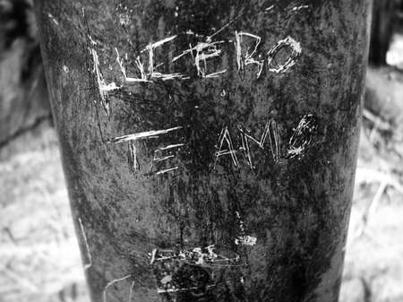 Detail of the engraving on a post, black and white, of the legend
