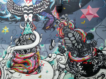 Sao Paulo, Sao Paulo, Brazil; 11222014: Colorful mural of street art with psychedelic figures and abstract eagles and eyes located in Batman Alley or Beco do Batman, a street with graffiti in Sao Paulo