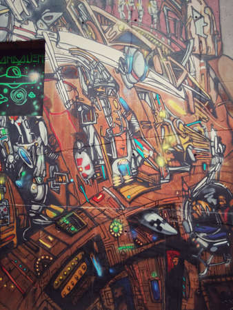Sao Paulo, Sao Paulo, Brazil; 11222014: Colorful mural of street art about steam punk, futuristic and nuclear shape of machinery with space ideas and concepts located in Batman Alley or Beco do Batman, a street with graffiti in Sao Paulo Editorial