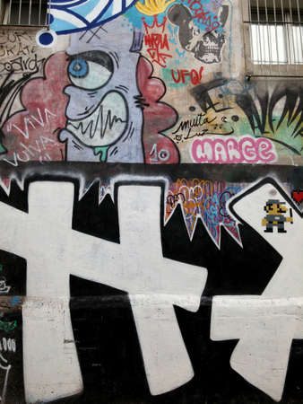 Sao Paulo, Sao Paulo, Brazil; 11222014: Colorful mural of street art about names, cartoons, and modern concepts in art, located in Batman Alley or Beco do Batman, a street with graffiti in Sao Paulo