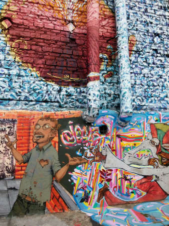 Sao Paulo, Sao Paulo, Brazil; 11222014: Colorful mural of street art about conceptual psychedelic textures about people located in Batman Alley or Beco do Batman, a street with graffiti in Sao Paulo Editorial