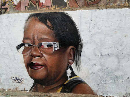 Sao Paulo, Sao Paulo, Brazil; 11222014: Colorful mural of street art about a stunning African American woman with glasses and jewelry, Brazilian culture, located in Batman Alley or Beco do Batman, a street with graffiti in Sao Paulo Editorial