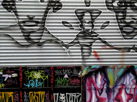 Sao Paulo, Sao Paulo, Brazil; 11222014: Colorful mural of street art about people in cartoon style and different grafitti letters located in Batman Alley or Beco do Batman, a street with graffiti in Sao Paulo Editorial