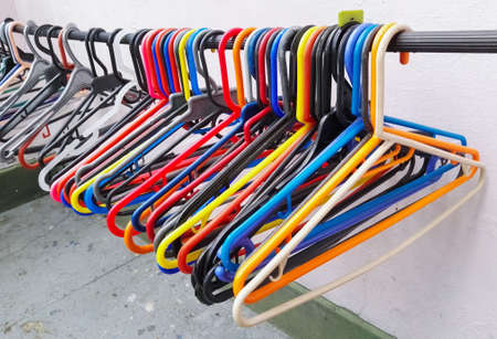 Clothes hanger or hook for hanging clothes with multiple stunning and bright colors, yellow, blue, red