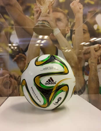"""Soccer ball used in the FIFA World Cup Brazil 2014. Called """"Brazuca"""" with white, yellow, green and black colors located in a museum."""