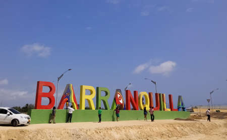 Signboard with the word Barranquilla, in this city of Colombia. Tourists observing the place where there will be a park with the letters of the Atlantico capital.