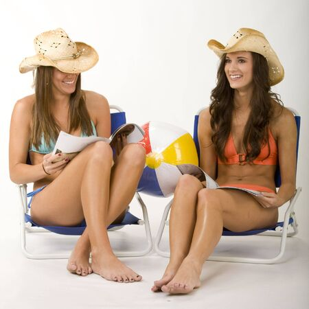cowgirls: Girls on the beach Stock Photo