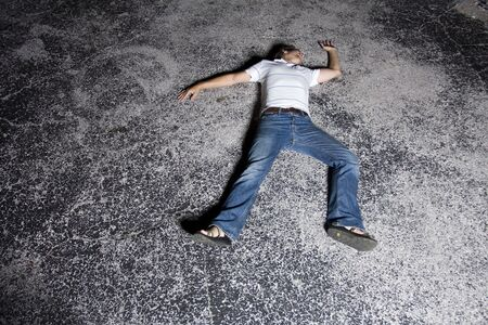 sandles: Young white male outside at night in a dark parking lot Stock Photo