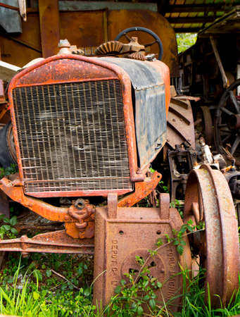 derelict: old rusty derelict farm tractor Editorial