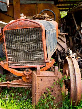 old rusty derelict farm tractor Редакционное
