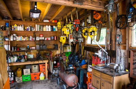 old workshop shed with equipment, power tools and supplies