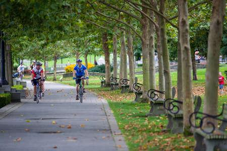 cyclists on park promenade, Coal Harbour, Vancouver, British Columbia