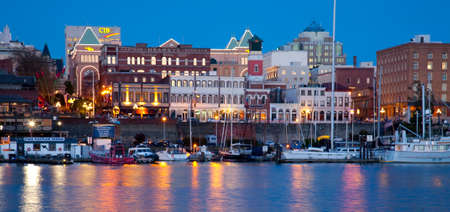 vancouver island: view of shops along Inner Harbour, Victoria at night, Vancouver Island, British Columbia Editorial