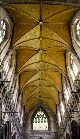 detail of ornate gold ceiling in a medieval cathedral, Chester, UK