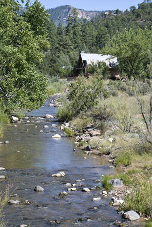 rt: log cabin on creek