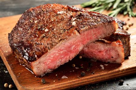cutted: Prime Black Angus Ribeye steak. Medium Rare degree of steak doneness.