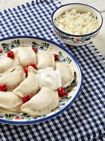 Varenyky. Popular food in Slavic (Polish, Slovak, Ukrainian, Russian), Baltic (Latvian, Lithuanian) and other Eastern European cuisines. Stock Photo