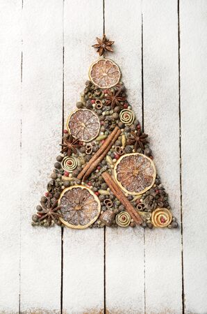 orange peel clove: Christmas tree made of spices on wooden background