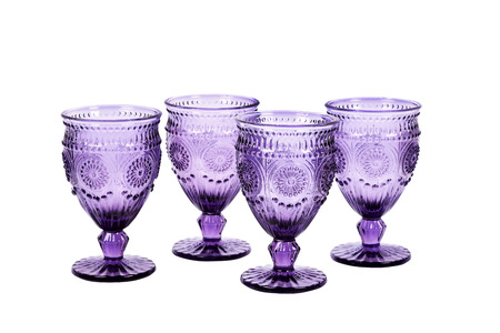 stemware: Set of four purple wineglasses with pattern isolated on white Stock Photo