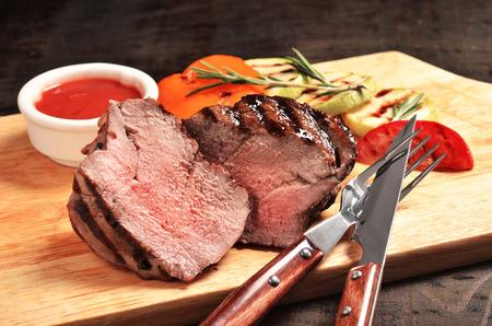 Prime Black Angus Filet mignon steak with grilled vegetables. Medium Rare degree of steak doneness.
