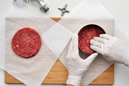 Cooking a Prime Black Angus beef burger patties. Top view.