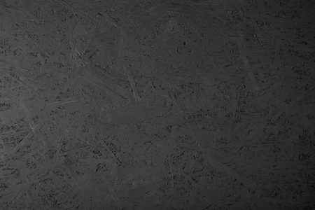 Black painted OSB plate. The image can be used as a background. 免版税图像