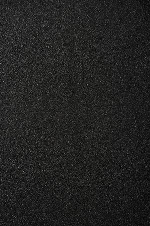 Black sand background. Top view. 免版税图像