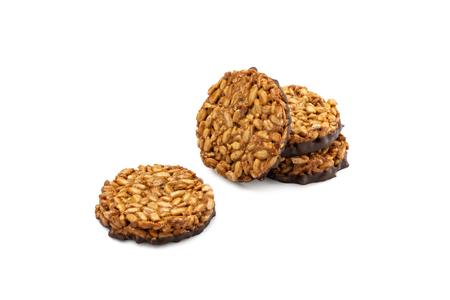 Sunflower seeds gozinaki with dark chocolate isolated on white