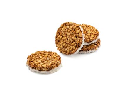 Sunflower seeds gozinaki with white chocolate isolated on white 免版税图像