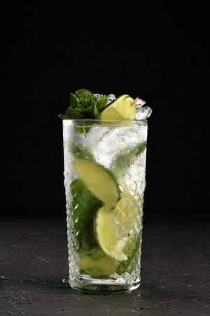 Traditional Mojito on black painted OSB background
