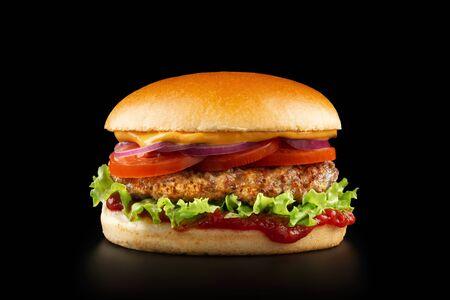 Fresh juicy burger on black background