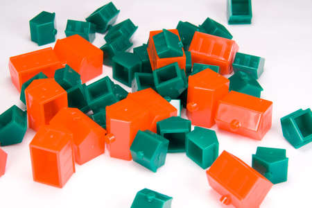 unpredictable: A random, chaotic jumble of plastic red and green houses. Stock Photo