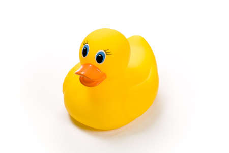 squeaky clean: Yellow bath toy, rubber ducky isolated against white background Stock Photo