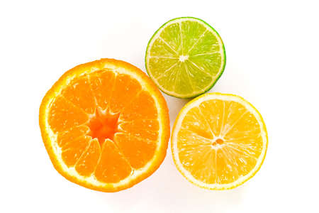 Half a wet orange, lemon and lime closeup, isolated against a white background. Stock Photo - 239267