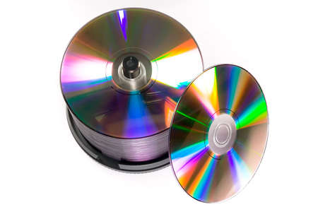 dvdr: A cake boxspindle of DVD-R discs, isolated against a white background. Stock Photo