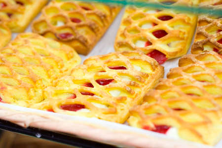Lattice patterned danishes cooling in a bakery. Stock Photo