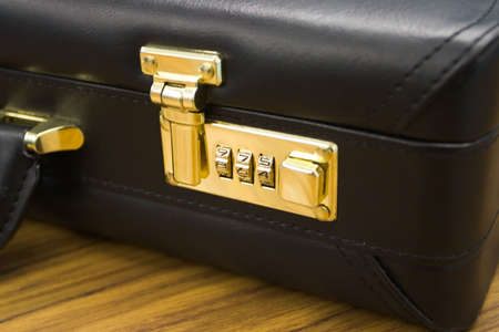 combination: A closeup shot of a briefcase with the combination lock in focus.