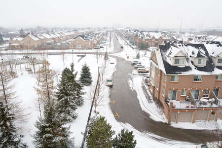 Wideangle, elevated view of a gray winter suburban landscape. photo