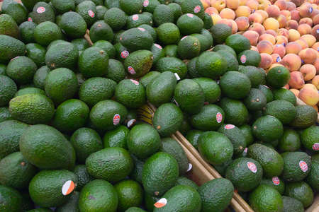 A pile of avocados at the local grocery store. Stok Fotoğraf