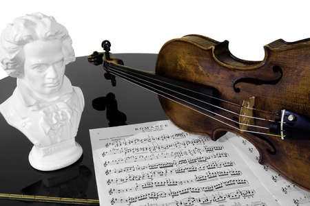 beethoven: A violin, score, and bust of Beethoven atop a piano, isolated against a white background.