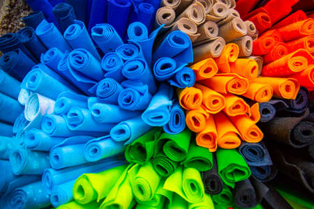 Colorful material fabric rolls. colorful background