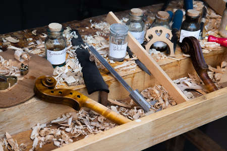 The old bench of violin makers in a workshop of a luthier