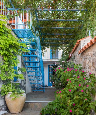 Flowers In A Greek Village Garden With Flower Pots, Trellis And ...